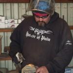 Shane Hakins welding
